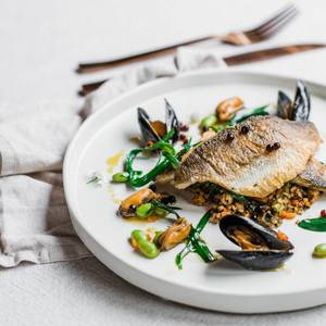 Fillet of fish with mussels and herbs